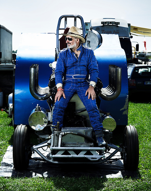"""BOUCONVILLE, FRANCE. AUGUST 21, 2011. Michel Thuard and his tractor named """"Vulcain"""". Tractor Pulling: Eurocup 2011. Photo: Antoine Doyen"""