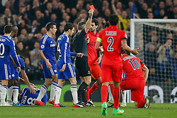 Zlatan Ibrahimovic of Paris Saint-Germain (pictured kneeling to the right) is shown a red card by referee Bjorn Kuipers for a challenge on Oscar of Chelsea - Photo mandatory by-line: Rogan Thomson/JMP - 07966 386802 - 11/03/2015 - SPORT - FOOTBALL - London, England - Stamford Bridge - Chelsea v Paris Saint-Germain - UEFA Champions League Round of 16 Second Leg.