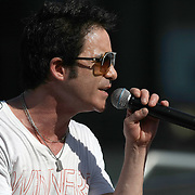 Pat Monahan of the Grammy award winning band Train sings during a one hour performance prior to the start of the NASCAR Coke Zero 400 race at Daytona International Speedway in Daytona Beach, Fl., on Saturday July 7, 2012. (AP Photo/Alex Menendez) Grammy Award winning band TRAIN plays an hour long concert prior to the NASCAR Coke Zero 400 race at Daytona International Speedway in Daytona Beach, Florida on July 7, 2012.