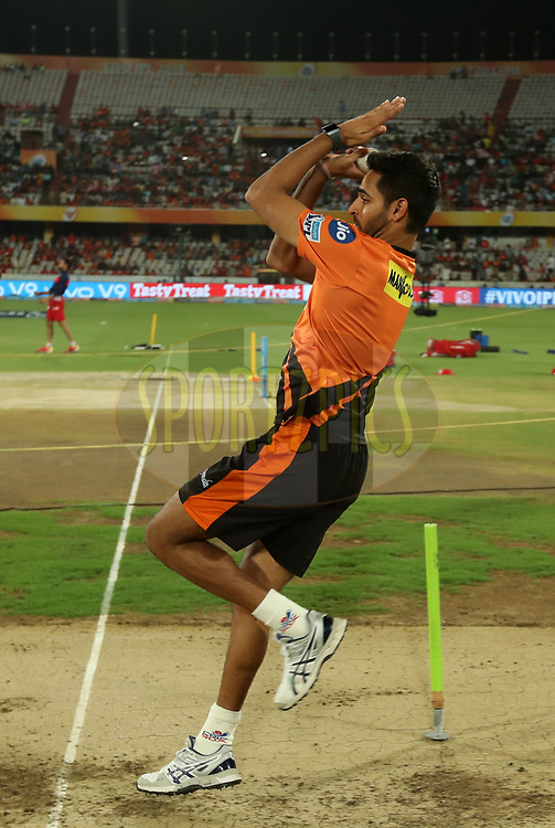 Bhuvneshwar Kumar of Sunrisers Hyderabad warming up during match twenty five of the Vivo Indian Premier League 2018 (IPL 2018) between the Sunrisers Hyderabad and the Kings XI Punjab  held at the Rajiv Gandhi International Cricket Stadium in Hyderabad on the 26th April 2018.<br /> <br /> Photo by: Prashant Bhoot /SPORTZPICS for BCCI