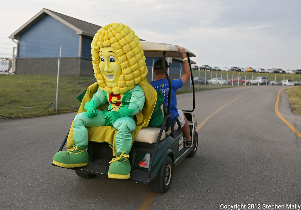 A corn mascot rides a golf cart before the start of the IZOD IndyCar Iowa Corn Indy 250 auto race at the Iowa Speedway in Newton, Iowa on Saturday, June 23, 2012.