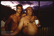 Wealthy merchant/rancher, Manuel Carvalho, and young admirer go shirtless @ ranch party;Eirunepe Brazil