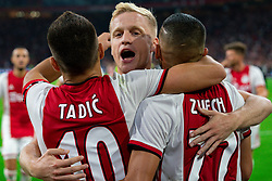 13-08-2019 NED: UEFA Champions League AFC Ajax - Paok Saloniki, Amsterdam<br />  Ajax won 3-2 and they will meet APOEL in the battle for a group stage spot / Dusan Tadic #10 of Ajax scores 3-1, Hakim Ziyech #22 of Ajax, Donny van de Beek #6 of Ajax