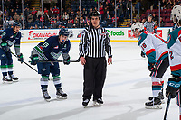 KELOWNA, CANADA - JANUARY 5: Linesman Kevin Crowell stands at the face off between Donovan Neuls #19 of the Seattle Thunderbirds and Kole Lind #16 of the Kelowna Rockets on January 5, 2017 at Prospera Place in Kelowna, British Columbia, Canada.  (Photo by Marissa Baecker/Shoot the Breeze)  *** Local Caption ***