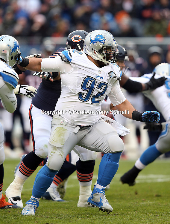 Detroit Lions defensive tackle Haloti Ngata (92) shakes off a block as he chases the action during the NFL week 17 regular season football game against the Chicago Bears on Sunday, Jan. 3, 2016 in Chicago. The Lions won the game 24-20. (©Paul Anthony Spinelli)