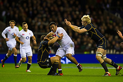England replacement (#18) Mako Vunipola (Saracens) is tackled during the second half of the match - Photo mandatory by-line: Rogan Thomson/JMP - Tel: Mobile: 07966 386802 02/02/2013 - SPORT - RUGBY UNION - Twickenham Stadium - London. England v Scotland - 2013 RBS Six Nations Championship. The winner of this fixture is awarded the Calcutta Cup.
