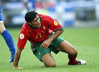 Fotball<br /> EURO 2004<br /> Portugal<br /> 12.06.2004<br /> NORWAY ONLY<br /> <br /> Hellas v Portugal<br /> <br /> Foto: Scott Heavey/Digitalsport<br /> <br /> Luis Figo struggles to get up after the 2-1 defeat