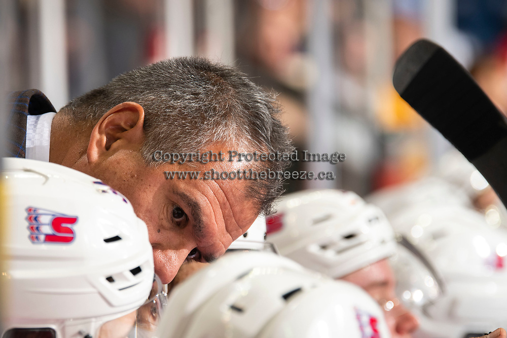 KELOWNA, BC - SEPTEMBER 21:  Spokane Chiefs' head coach Manny Viveiros speaks to players on the bench against the Kelowna Rockets at Prospera Place on September 21, 2019 in Kelowna, Canada. (Photo by Marissa Baecker/Shoot the Breeze)