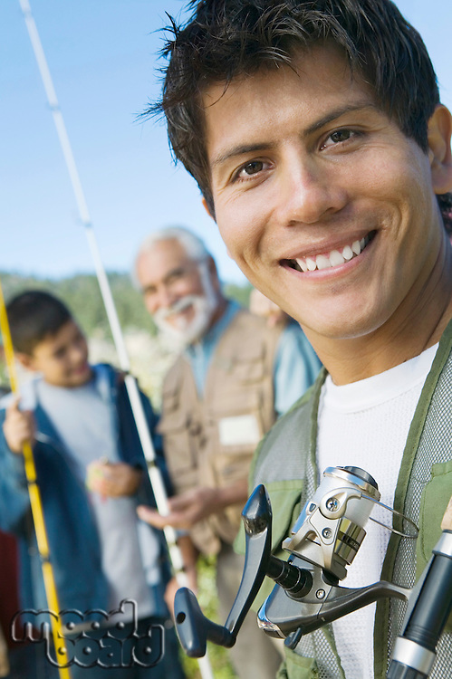 Smiling Man on Fishing Trip with Father and Son