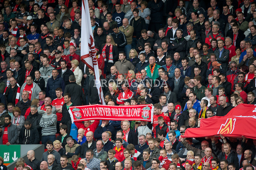 LIVERPOOL, ENGLAND - Saturday, April 7, 2012: Liverpool supporters stand for a minute's silence to remember the 96 victims of the 1989 Hillsborough Stadium Disaster before the Premiership match against Aston Villa at Anfield. (Pic by David Rawcliffe/Propaganda)