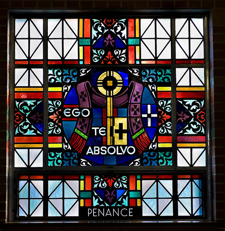 Stained glass image illustrating Sacrament of Penance at St. Mary Church in Peshtigo, Wis. (Sam Lucero photo)