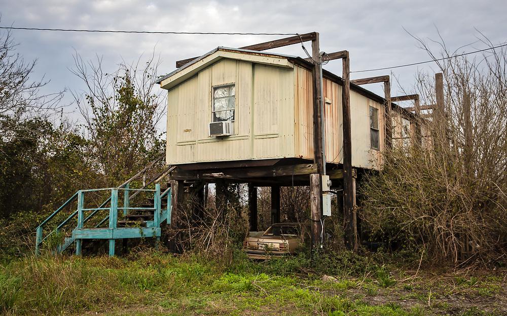 Raised abandoned home on Isle de Jean Charles, in Louisiana.