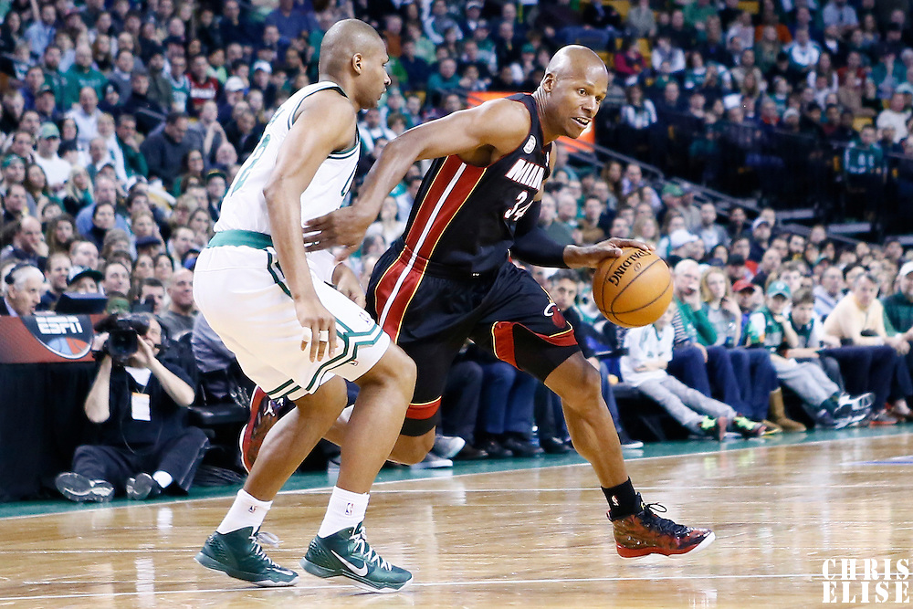 27 January 2013: Miami Heat shooting guard Ray Allen (34) drives past Boston Celtics shooting guard Leandro Barbosa (12) during the Boston Celtics 100-98  2OT victory over the Miami Heat at the TD Garden, Boston, Massachusetts, USA.