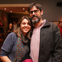Shannon Gentry, left, and Tom Dorgan pose for a picture Sunday December 21, 2014 during the Brooklyn Arts District Christmas party at Canape in Wilmington, N.C. (Jason A. Frizzelle)