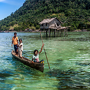 Bajau children learn to play on the sea at an early age.