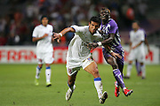 Fode Mansare (R) is fouled by Cora Tayfun of Trabzonspor. Toulouse v Trabzonspor, Europa Cup, Second Leg, Stade Municipal, Toulouse, France, 27th August 2009.