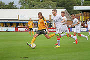 Cambridge Utd defender Blair Adams (3) gets in a shot during the EFL Sky Bet League 2 match between Cambridge United and Luton Town at the R Costings Abbey Stadium, Cambridge, England on 27 August 2016. Photo by Nigel Cole.