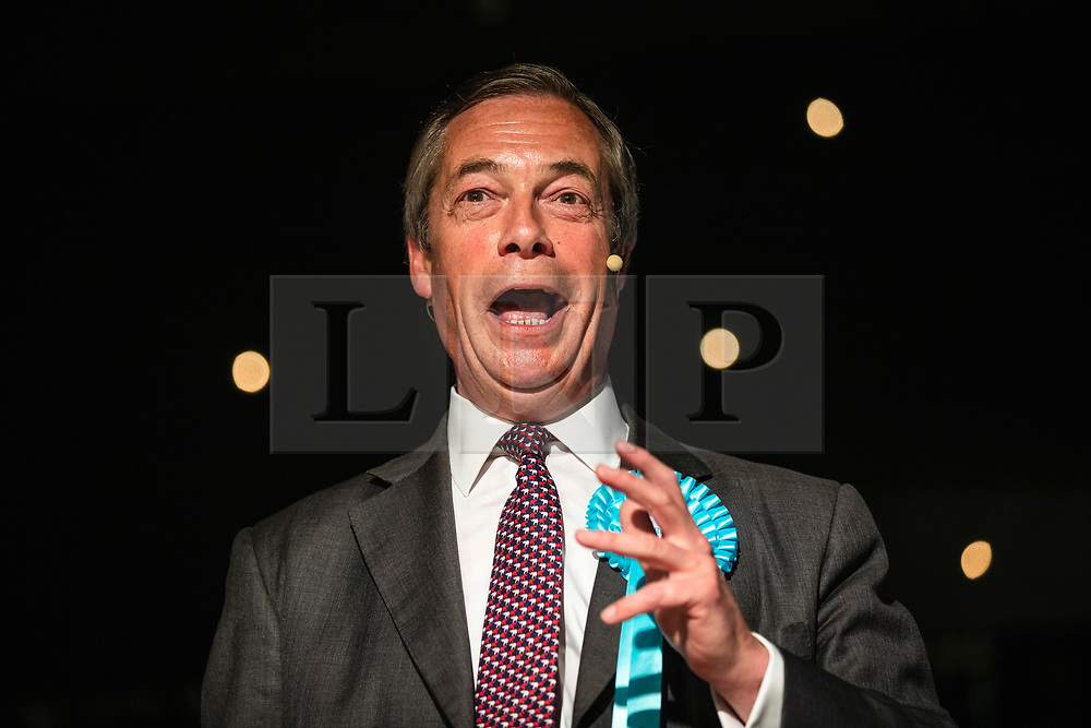 © Licensed to London News Pictures. 19/05/2019. Frimley, UK. Leader of The Brexit Party Nigel Farage addresses supporters at a party rally in Frimley, Surrey, ahead of the European Elections. Photo credit: Rob Pinney/LNP