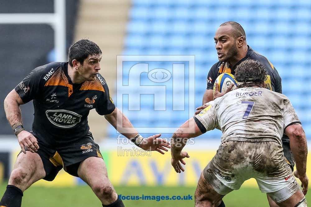 Sailosi Tagicakibau of Wasps (upper right) confronts Jacques Burger of Saracens (right) as James Downey of Wasps (left) waits during the Aviva Premiership match at the Ricoh Arena, Coventry<br /> Picture by Andy Kearns/Focus Images Ltd 0781 864 4264<br /> 08/03/2015