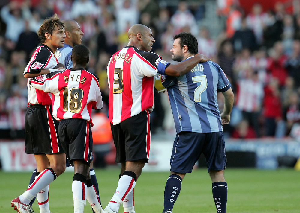Andy Reid shows his frustration at the sending off as Wayne Thomas attempts to calm him down. Southampton v Charlton Athletic, Championship, St Marys, Southampton. 3rd November 2007.