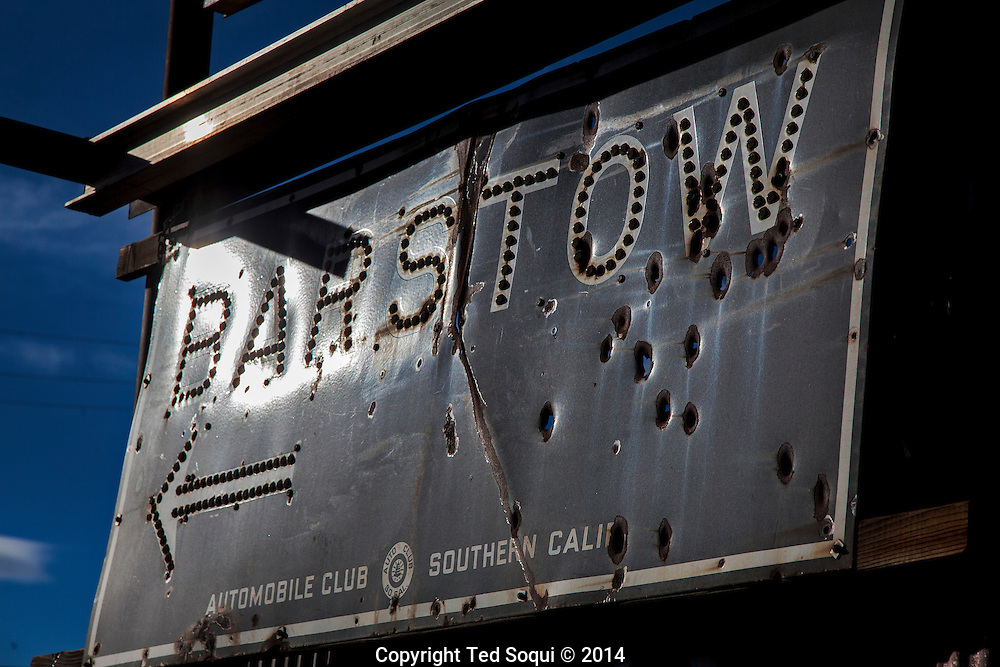 A bullet ridden sign in the city of Barstow, CA.<br /> U.S. Route 66, also known as the Mother Road, in the Mojave desert of California. The two major connector cites in the Mojave desert are Barstow and Amboy. U.S. Route 66 was the first major east west highway for the US, starting in Chicago, Il and ending in Santa Monica, CA. The 2,448 mile long highway was built in November 11,1926. Most of Route 66 has been decommissioned, but there are several parts that are now historically preserved.