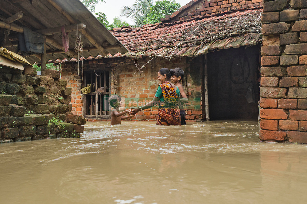July 27, 2017 - Kolkata, west bengal, india - Udaynarayanpur, Kolkata, West Bengal, India : Udaynarayanpur, a village of Howrah district .of West Bengal, India, where flood take place. On thursday 27th July 2017 Damodar valley .corporation (DVC) release more water from its dams and sounded  red alert on surrounding .areas villages including Udaynarayanpur. An additional 2,49,450 cusecs water released .from Durgapur barrage on 27th July morning which submerged the area completely. .People get dry food and tarpoolin as relief from West Bengal government. Entire area get .disconnected from all means of connecting medium. The disaster takes place when barrage .at Udaynarayanpur broken due to heavy flow of water that comes from dams. Till date 90 .villages submerged as per local officials report. (Credit Image: © Debsuddha Banerjee via ZUMA Wire)
