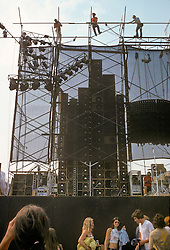 Crews setting up the Wall of Sound before the Grateful Dead Play Live at Dillon Stadium, Hartford, CT 31 July 1974. Gates have opened and the crowd gathers, late afternoon.