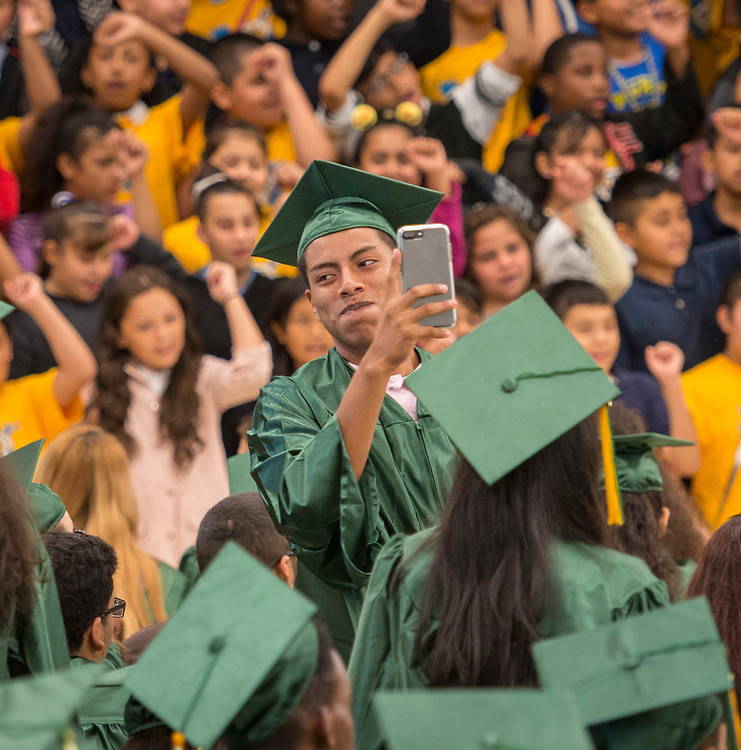 Graduating seniors from Sharpstown High School are greeted by studnets at Bonham Elementary School during a Grad Walk, May 25, 2017.