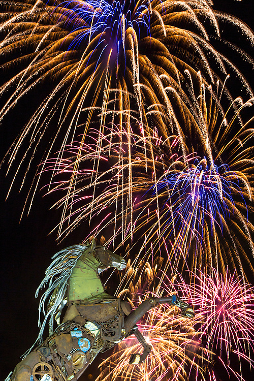 Fireworks burst over a sculpture in Whitehorse, Yukon, on New Year's Eve.