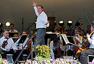 HYANNIS -- 081014 -- Charlie Rose reacts to dropping the baton before guest conducting the Boston Pops Esplanade Orchestra during the 29th annual Pops by the Sea on the Hyannis Village Green.  Christine Hochkeppel/Cape Cod