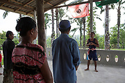 Supot Kalasong, 42, talks during the daily morning meetings. Every morning at 7am the villagers of Klong Sai Pattana meet, take role-call, talk about anything out of the ordinary the previous day, voice any grievances and do morning exercises. They understand that in such a prolonged and dangerous battle their strength is in their cohesion. The morning meetings as well as monthly group projects are aimed at keeping the community together and strong.<br /> <br /> Since 2008, this community of around 70 families have been embroiled in a conflict with a palm oil company that locals allege has been trying to violently evict them. Since 2010, four members of the community have been shot dead and a fifth shot, but survived.<br /> <br /> For decades the palm oil company Jiew Kang Jue Pattana Co., Ltd has illegally occupied and cultivated palm oil trees on a 535-acre plot of land in the Chai Buri District of Surat Thani Province. <br /> <br /> The company operated with no official legal documentation or land concession, until the Southern Peasant's Federation of Thailand (SPFT), who supports the community, began investigating them and collecting evidence.<br /> <br /> This evidence ultimately lead to a Supreme Court ruling against the company for illegal trespassing and land encroachment. But the community still struggles to remain on the land to this day with the last shooting happening in April 2016, years after the court case was won.