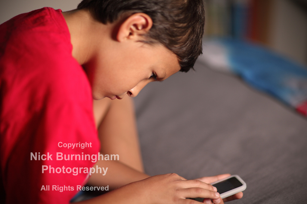 Boy with phone - EXCLUSIVELY AVAILABLE HERE