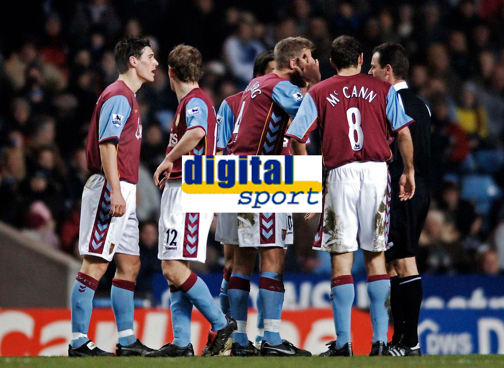 Photo: Glyn Thomas.<br />Aston Villa v Chelsea. Barclays Premiership. 01/02/2006.<br />Aston Villa players protest to referee Rob Styles (R) that they should have been awarded a penalty for hand ball.