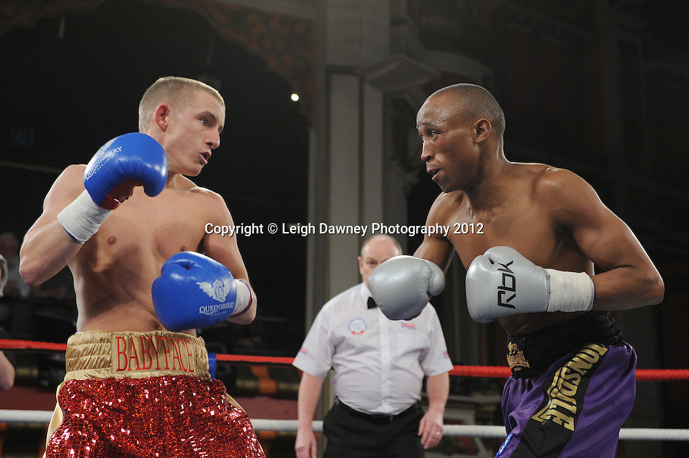 Paul Butler (red/gold shorts) defeats Michael Ramabeletsa in a 8x3min Super Flyweight contest at Olympia, Liverpool on the 20th January 2012. Vaughan Boxing Promotions. © Leigh Dawney Photography 2012.