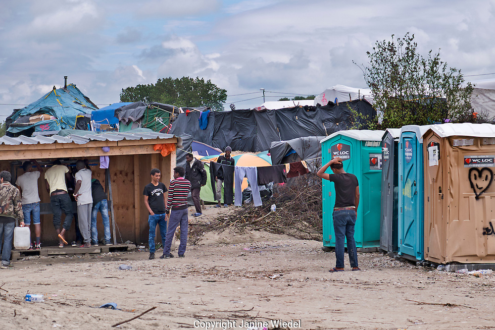 Washing facilities in The Calais Jungle Refugee and Migrant Camp in France