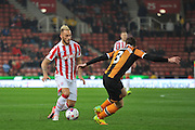 Stoke City forward Marko Arnautovic  looks to take on the defender during the EFL Cup match between Stoke City and Hull City at the Britannia Stadium, Stoke-on-Trent, England on 21 September 2016. Photo by John Marfleet.