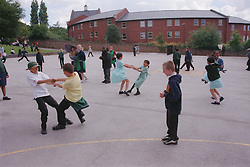 Primary school children playing in school playground,