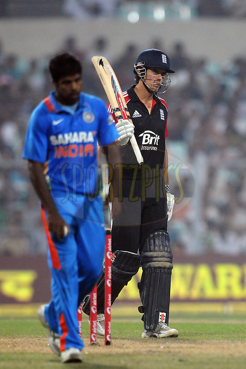 Alastair Cook of England celebrates after hitting a half century during the 5th One Day International ( ODI ) match between India and England held at the Eden Gardens Stadium, Kolkata on the 23rd October 2011..Photo by Pal Pillai/BCCI/SPORTZPICS