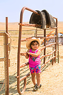 Crow Fair, granddaughter of Henry Real Bird in camp, Crow Indian Reservation, Montana