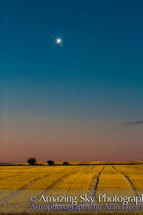 Venus and Mars in close conjunction in the dawn sky on October 5, 2017. Venus is the brightest object; Mars is below it; while the star above Venus is 4th magnitude Sigma Leonis. The foreground is illuminated by light from the setting Full Moon in the west.<br /> <br /> This is a single 3.2-second exposure with the 135mm lens at f/3.5 and Canon 60Da at ISO 800. Being stopped down, the lens provided some diffraction spikes on Venus.