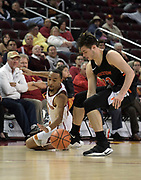 Dec 19, 2017; Los Angeles, CA, USA; Princeton Tigers forward Sebastian Much (33) and Southern California Trojans guard Jordan McLaughlin (11) battle for the ball during an NCAA basketball game at Galen Center. Princeton defeated USC 103-93 in overtime.