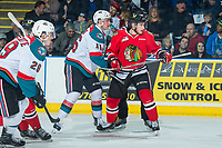 KELOWNA, CANADA - APRIL 8: Kole Lind #16 of the Kelowna Rockets checks Matt Revel #18 of the Portland Winterhawks on April 8, 2017 at Prospera Place in Kelowna, British Columbia, Canada.  (Photo by Marissa Baecker/Shoot the Breeze)  *** Local Caption ***