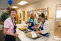 Sharon Fleischman, Cindy Waltman and Melody Funk serve up about 900 meat and potato knishes during Sunday's Jewish Food Festival at Temple B'nai Isreal on Court Street.   (Karen Bobotas/for the Laconia Daily Sun)