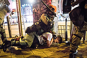 HONG KONG: 13 October 2019 <br /> A protester is arrested in the Sham Shui Po district of Hong Kong earlier this evening. Running battles between protesters and riot police continued today as demonstrators move into their 19th consecutive week of protests in Hong Kong. The movement's aim, which started on June 1st, originally wanted to get rid of a controversial extradition bill which has since been removed, however the protests have formed into a wider fight against police brutality and the ability to wear a mask without fear of arrest.<br /> Rick Findler / Story Picture Agency