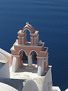 Greek Orthodox church, exterior, pink & white bell tower, Cycladic architecture,Aegean Sea