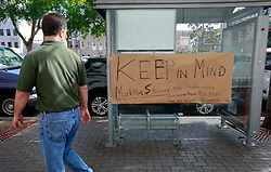 09 July 2014. New Orleans, Louisiana. <br /> A man stops to look at a sign posted to a bus shelter outside Federal Court at the trial of  Ray Nagin. Former mayor of New Orleans is sentenced to serve 10 years in prison for bribery and money laundering. <br /> Photo; Charlie Varley/varleypix.com