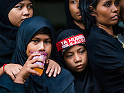 24 OCTOBER 2015 - YANGON, MYANMAR: Shia women watch men and boys participate in ritual self flagellation with razors and chains during Ashura observances at Mogul Mosque in Yangon. Ashura commemorates the death of Hussein ibn Ali, the grandson of the Prophet Muhammed, in the 7th century. Hussein ibn Ali is considered by Shia Muslims to be the third imam and the rightful successor of Muhammed. He was killed at the Battle of Karbala in 610 CE on the 10th day of Muharram, the first month of the Islamic calendar. According to Myanmar government statistics, only about 4% of the population is Muslim. Many Muslims have fled Myanmar in recent years because of violence directed against Burmese Muslims by Buddhist nationalists.    PHOTO BY JACK KURTZ