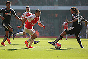 Arsenal forward, Alexis Sanchez (17) wrong footing Watford defender, Nathan Ake (16) during the The FA Cup Quarter Final match between Arsenal and Watford at the Emirates Stadium, London, England on 13 March 2016. Photo by Matthew Redman.