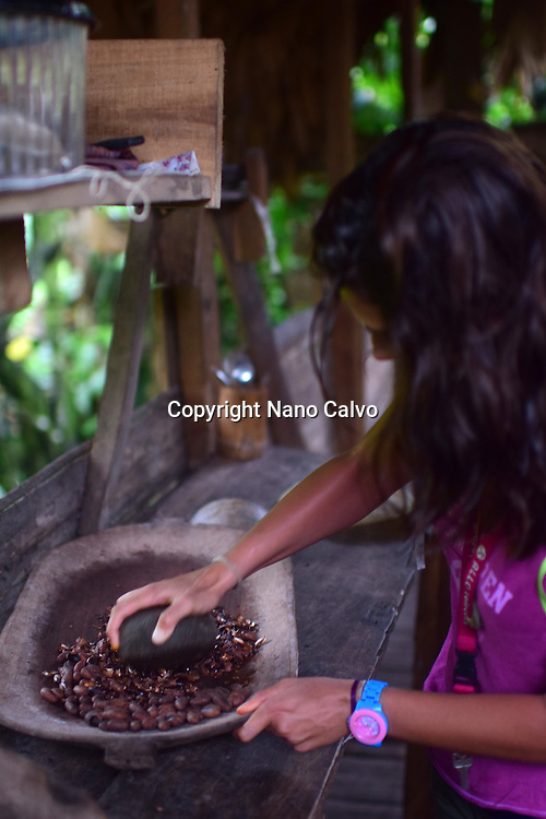 Preparing natural cacao drink at Bribri tribe house. <br />
