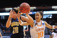 Mar 23, 2013; Knoxville, TN, USA; Oral Roberts Golden Eagles guard Jaci Bigham (22) and Tennessee Lady Volunteers guard Meighan Simmons (10) battle for a loose ball in the first half during the first round of the 2013 NCAA womens tournament at Thompson Boling Arena. Mandatory Credit: Randy Sartin-USA TODAY Sports